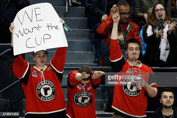 Quebec Remparts fans cheer during the second period in Game One of the Memorial Cup at the Pepsi Coliseum on May 22 2015 in Quebec City Quebec Canada