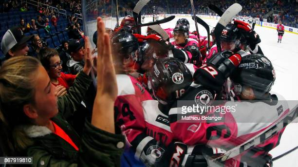 Quebec Remparts players celebrate their victory against the the Sherbrooke Phoenix during their QMJHL hockey game at the Centre Videotron on October...
