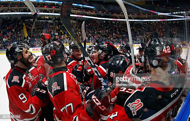Quebec Remparts players congratulate their teammate Jesse Sutton for his game winning goal in overtime against the RouynNoranda Huskies during their...