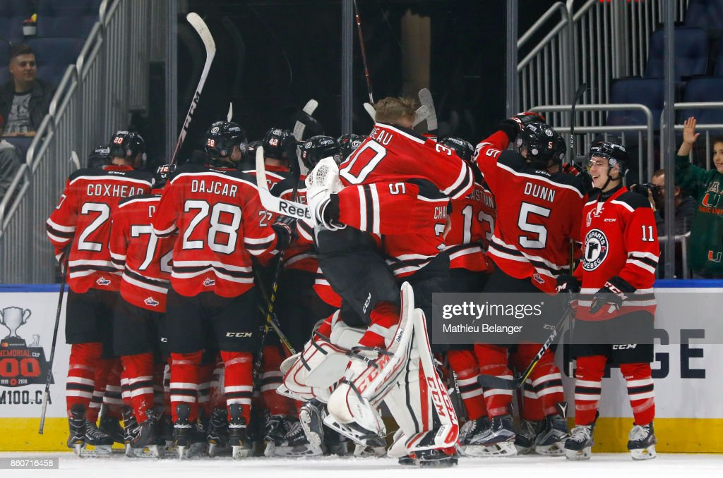 Quebec Remparts players their overtime victory against the Victoriaville Tigres during their QMJHL hockey game at the Centre Videotron on October 12, 2017 in Quebec City, Quebec, Canada.
