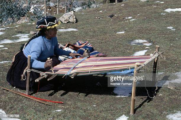 Quechua 'Inca' woman weaving on a horizontal single-heddle loom, Peru ,Inca.
