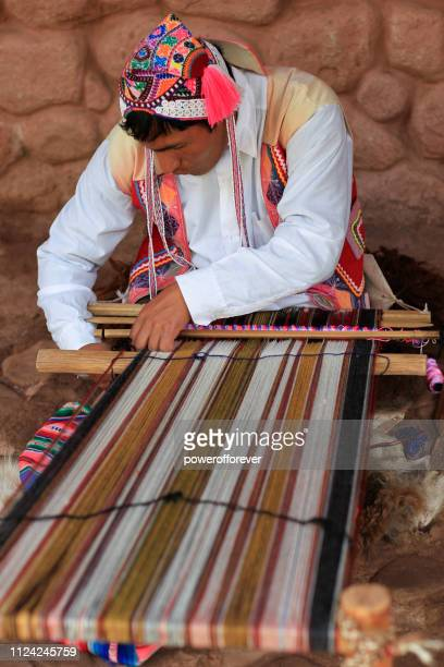 Quechua Man Weaving in the Sacred Valley of the Incas of Peru
