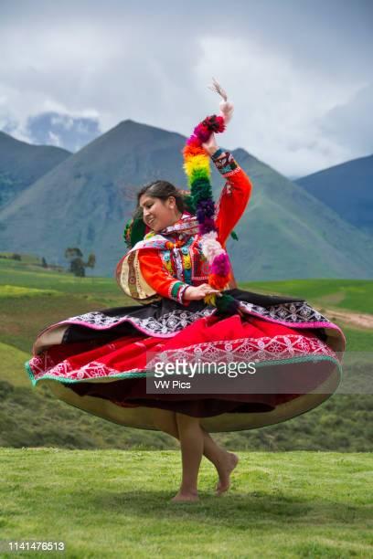 Quechua woman dancing in performance at El Parador de Moray, Sacred Valley, Peru.
