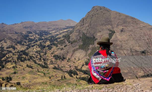 Quechua woman looking at the landscape near Cusco