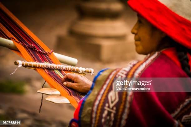 Quechua woman weaving yarn