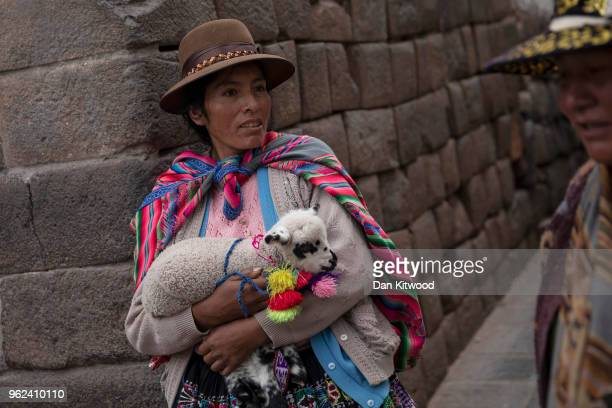 Quechua women hawk for tourists to take photographs with on May 24, 2018 in Cusco, Peru. Cusco was the capital of the Inca Empire between the 13th...