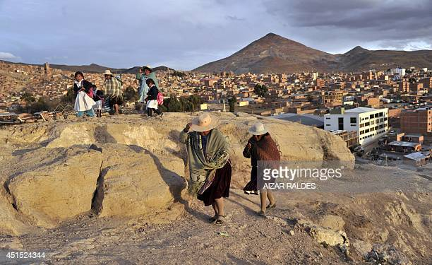 Quechua women walk in the outskirts of Potosi on June 24 2014 UNESCO's World Heritage Committee has recently added the colonial city of Potosi to the...