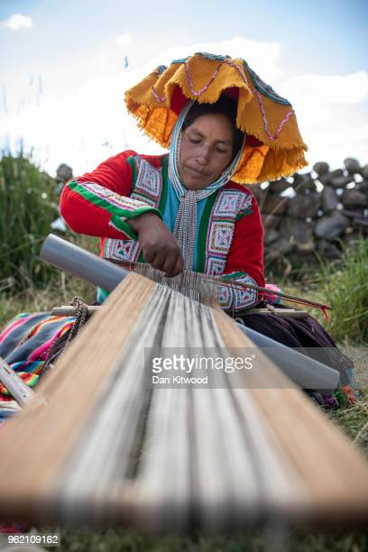 Quechua women weaves on May 23, 2018 in Tinki, Peru. Many Quechua families, especially women in high altitude isolated communities have little or no...