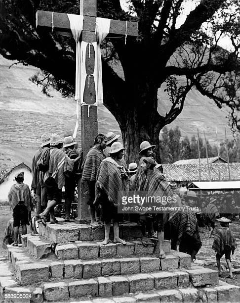 Quechuas at the Base of a Cross Peru