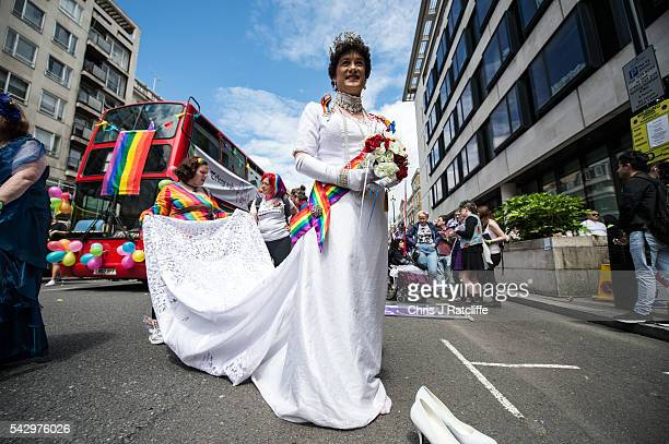 'Queen Alexandra' aka Stephen StephensonSpencer makes his way to the march as the LGBT community celebrates Pride in London on June 25 2016 in London...