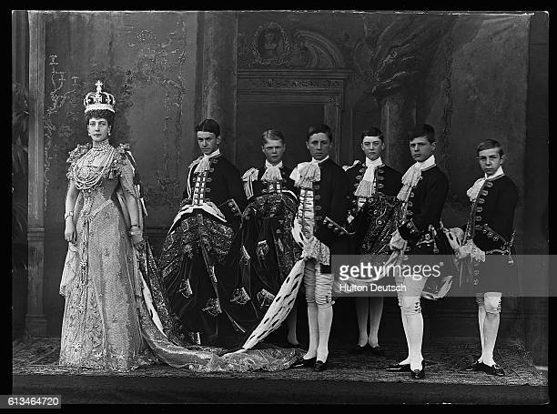 Queen Alexandra poses with her pages after the 1901 Coronation of her husband as King Edward VII.