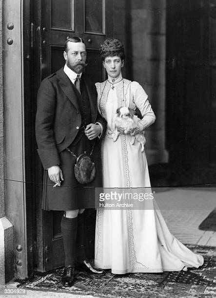 Queen Alexandra, , queen-consort of King Edward VII, who ascended the British throne in 1901, with her eldest son King George V, , then Prince of...