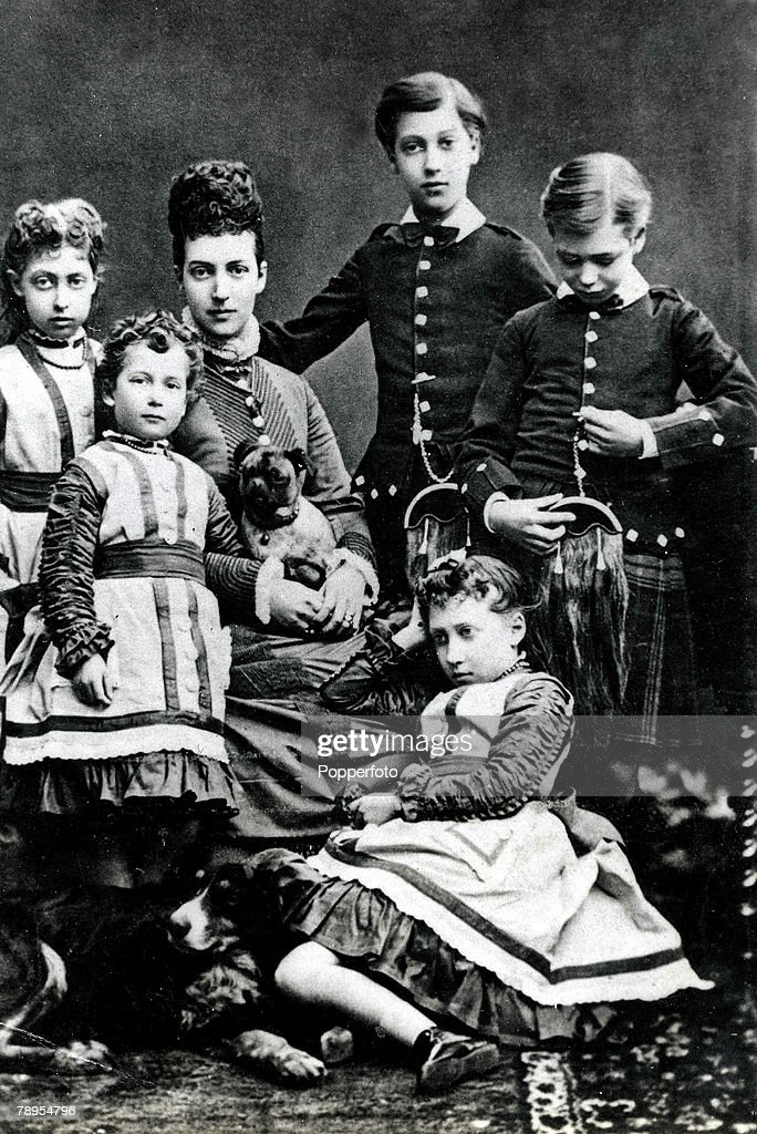 Queen Alexandra, (Consort to King Edward VII) with children, L-R: Princess Louise, Princess Maud, Queen Alexandra, Prince Albert Victor, Princess Victoria and George, (later to become King George VI). : News Photo