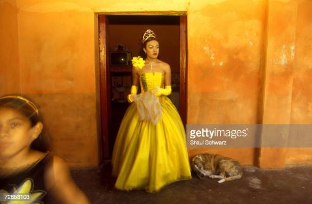 'Queen America' walks out of her room after finishing her preparations for the vela de la Santa Cruz del Cielo in Juchitan Mexico October 16 2002...