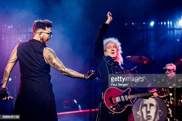 Queen and Adam Lambert perform at Ziggo Dome Amsterdam Netherlands 13th November 2017 LR singer Adam Lambert guitarist Brian May and drummer Roger...