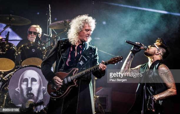 Queen and Adam Lambert perform at Ziggo Dome Amsterdam Netherlands 13th November 2017 LR drummer Roger Taylor guitarist Brian May and singer Adam...
