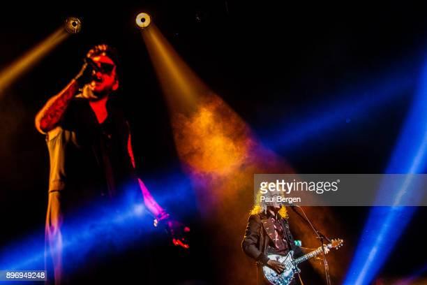 Queen and Adam Lambert perform at Ziggo Dome Amsterdam Netherlands 13th November 2017 LR singer Adam Lambert guitarist Brian May