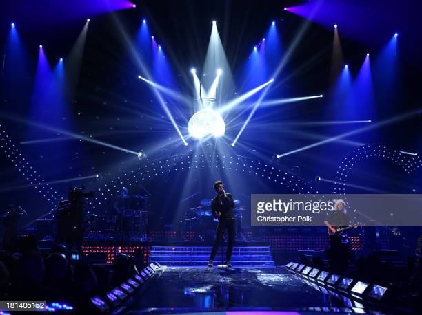 Queen and Adam Lambert perform onstage during the iHeartRadio Music Festival at the MGM Grand Garden Arena on September 20 2013 in Las Vegas Nevada