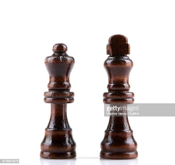 queen and king chess pieces against white background - chess piece stock pictures, royalty-free photos & images