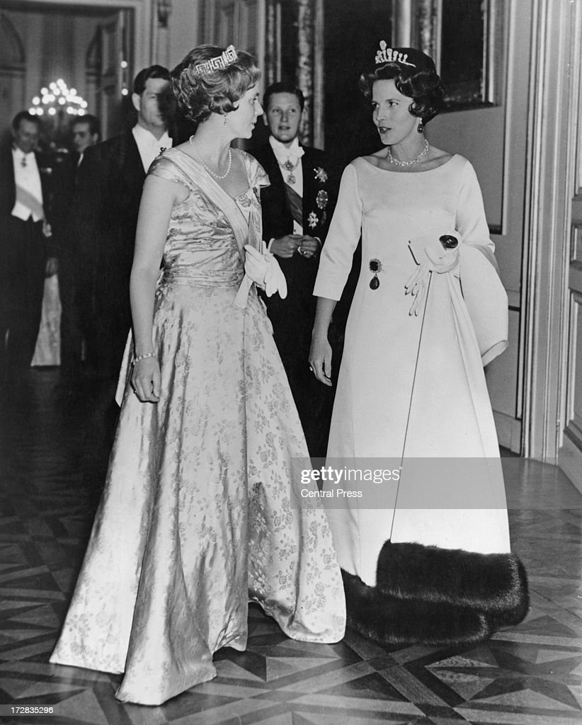 Queen Anne of Romania (left) and Princess Lilian of Belgium (1916 - 2002) followed by King Michael I of Romania and Simeon II of Bulgaria, attend a banquet given by the Belgian government at the Royal Palace of Brussels, 14th December 1960. The banquet is taking place for the guests who will be attending the wedding of King Baudouin of Belgium and Dona Fabiola de Mora y Aragon the following day.