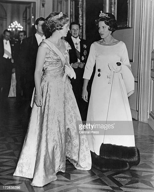 Queen Anne of Romania and Princess Lilian of Belgium followed by King Michael I of Romania and Simeon II of Bulgaria, attend a banquet given by the...