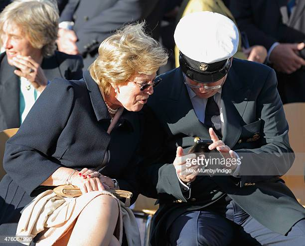 Queen AnneMarie of Greece looks at Prince Albert II of Monaco's mobile phone as they attend the Bicentenary Celebrations of The Royal Yacht Squadron...