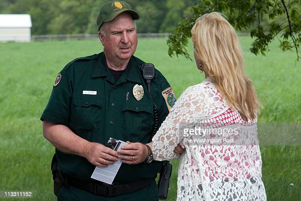 Queen Anne's County Senior Animal Control Officer Walt Tucker speaks with Michelle Louis founder of Halo's Haven Rescue an animal and equine...