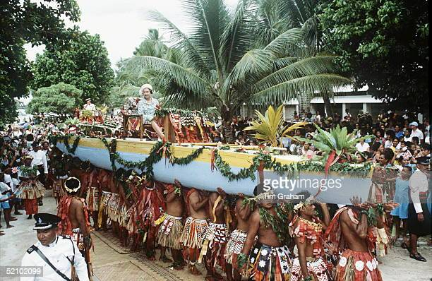 Queen Arrives In Tuvalu In The South Pacific She Was Rowed Ashore In A War Canoe And Is Being Carried Down The Main Street.