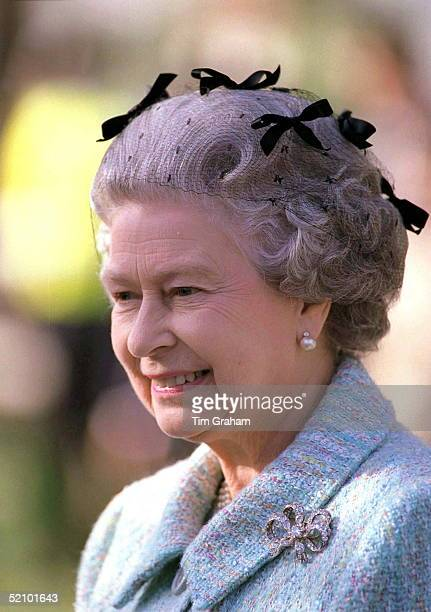 Queen At Chelsea Flower Show In London Wearing A Hairnet With Bows