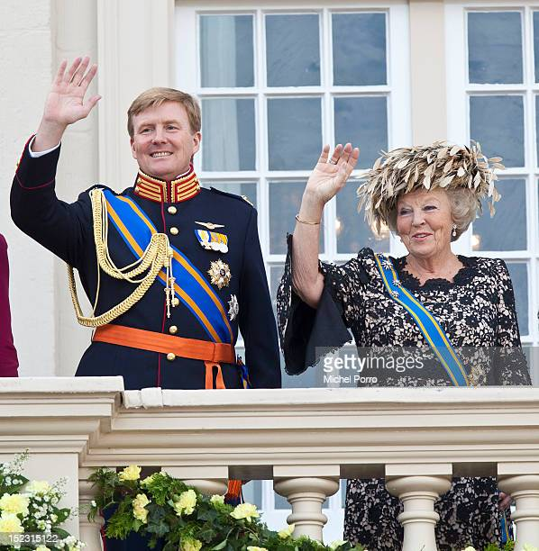 Queen Beatrix and Crown Prince Willem Alexander of The Netherlands wave from the Noordeinde Palace balcony after attending Budget Day announcement on...