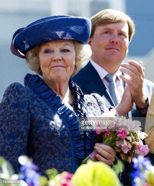 Queen Beatrix and Prince Willem-Alexander of the Netherlands look on during Queen's Day in Veenendaal on April 30, 2012. AFP PHOTO/ANP/ROBIN UTRECHT...