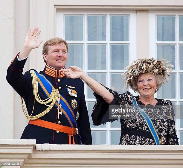 Queen Beatrix of the Netherlands and Crown Prince Willem Alexander wave from the Noordeinde Palace balcony after attending Budget Day announcement on...