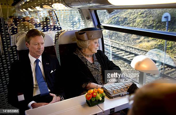 Queen Beatrix of The Netherlands and Grand Duke Henri of Luxembourg are pictured aboard a train from Luxembourg City to Belval in EschsurAlzette on...