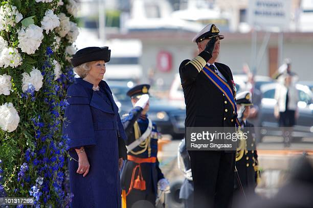 Queen Beatrix of the Netherlands and King Harald V of Norway attend a welcoming ceremony as the Dutch royal family visit at the harbour on June 1...