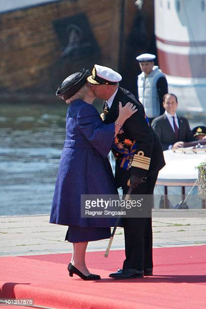 Queen Beatrix of the Netherlands and King Harald V of Norway embrace at a welcoming ceremony as the Dutch royal family visit at the harbour on June 1...