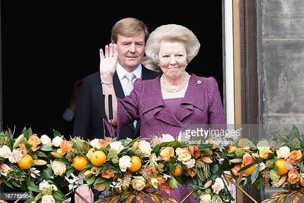 Queen Beatrix of the Netherlands and King Willem Alexander appear on the balcony of the Royal Palace to greet the public after her abdication and...