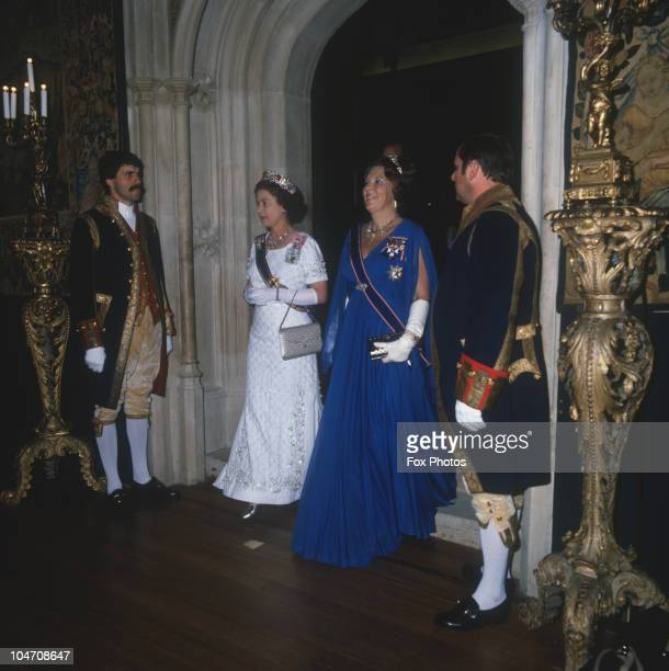 Queen Beatrix of the Netherlands and Queen Elizabeth II arrive at a state banquet held at Hampton Court Palace on November 18, 1982 .