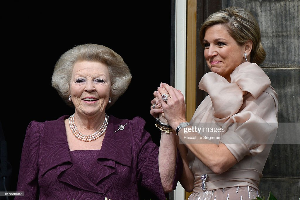 Queen Beatrix of the Netherlands and Queen Maxima (R) appear on the balcony of the Royal Palace to greet the public after her abdication and ahead of the Inauguration of King Willem Alexander of The Netherlands on April 30, 2013 in Amsterdam, Netherlands.