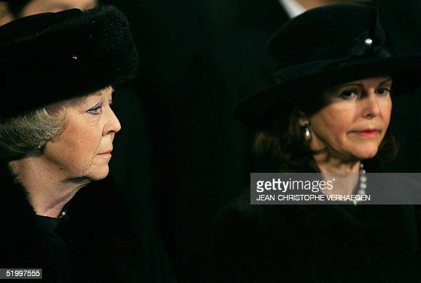 Queen Beatrix of the Netherlands and Queen Silvia of Sweden listen to a sermon during the funeral of Luxembourg Grand Duchess JosephineCharlotte at...