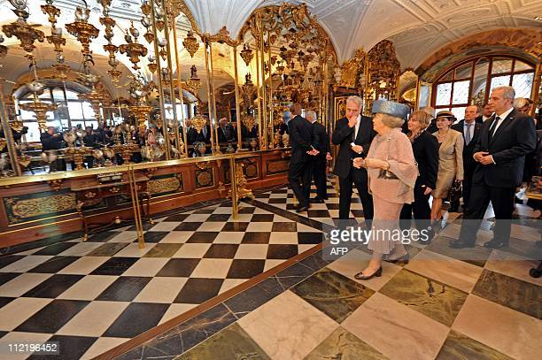 Queen Beatrix of the Netherlands and Saxony's Prime Minister Stanislaw Tillich visit the Green Vault in Dresden eastern Germany on April 14 2011 The...