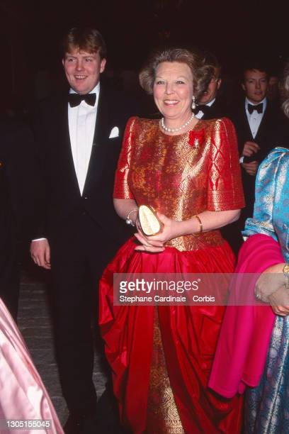 Queen Beatrix of the Netherlands and son Willem-Alexander of the Netherlands attend the reception on the eve of the wedding of Infanta Elena, Duchess...