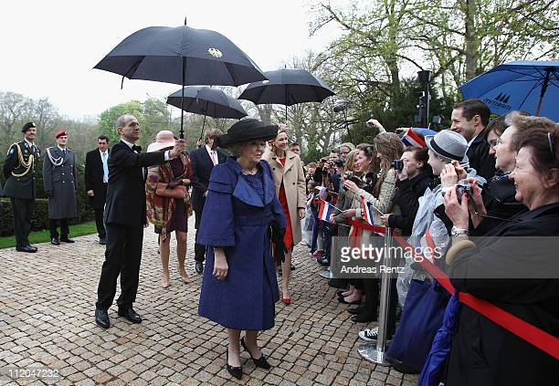 Queen Beatrix of the Netherlands greets school children at Bellevue Presidential Palace on April 12 2011 in Berlin Germany The Dutch royals are on a...
