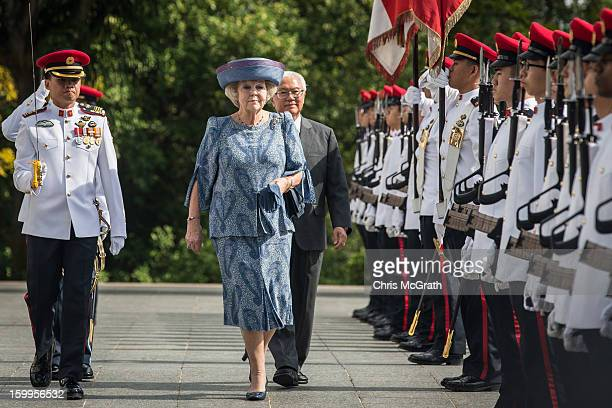 Queen Beatrix of the Netherlands inspects the honour guard with Singapore President Tony Tan at the Istana on January 24 2013 in Singapore Queen...