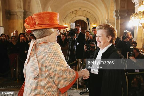 Queen Beatrix of the Netherlands is greeted by Judge Rosalyn Higgins to attend to celebrations marking the 60th anniversary of the International...