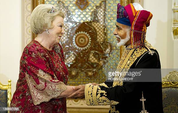 Queen Beatrix of the Netherlands is welcomed by Sultan Qaboos of Oman during a state banquet in the Al Alam Palace in Muscat on January 10 2012 The...