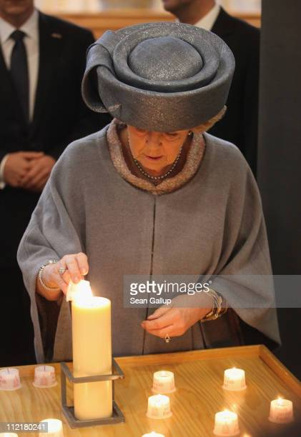 Queen Beatrix of the Netherlands lights a candle at the Frauenkirche Cathedral on April 14 2011 in Dresden Germany The Dutch royals including...