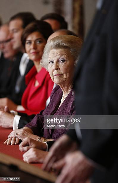 Queen Beatrix of the Netherlands looks on as The Director of the Queen's Office Chris Breedveld reads out the Act of Abdication in the Moseszaal at...