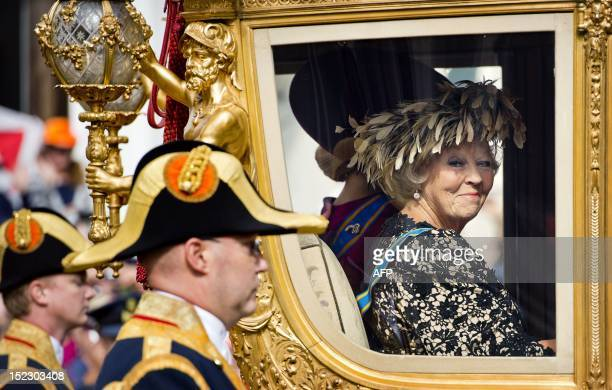 Queen Beatrix of The Netherlands looks on from the Golden Carriage as she leaves Noordeinde Palace for a ride to the Ridderzaal in The Hague on...