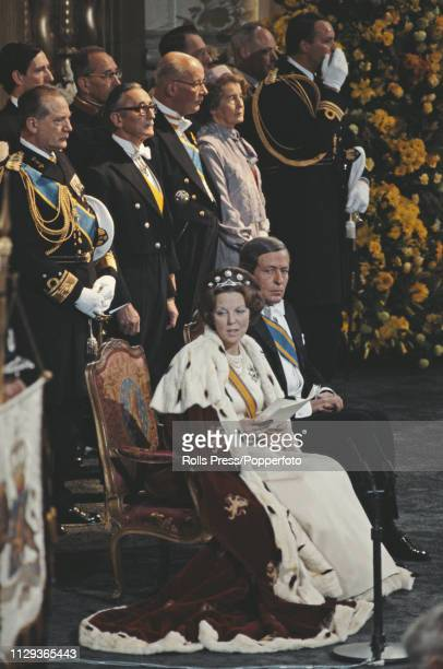 Queen Beatrix of the Netherlands pictured seated next to her husband, Prince Claus of the Netherlands during her inauguartion ceremony inside the...