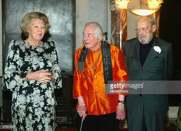 Queen Beatrix of the Netherlands poses with British author Alan Davidson and Prince Bernhard of the Netherlands after Davidson received the 2003...